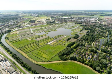 Aerial view of a residential area with large villa's and estates. The Thousand Islands in Broek op Langedijk, Holland. It is a nature reserve area with more then 1000 small islands. A clear horizon