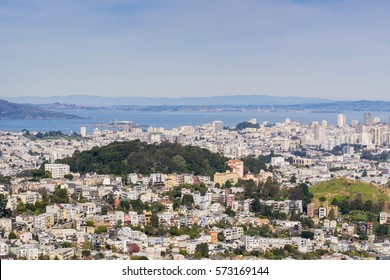 Aerial view of residential areas of San Francisco; San Francisco bay and Alcatraz island in the background, California