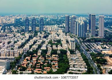Aerial view of residential buildings and modern office towers in Tel Aviv, Israel.
