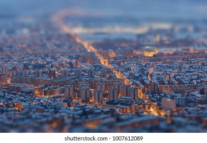 Aerial view of a residential district illuminated at twilight during winter, Brasov, Romania. Tilt-shift blur effect.