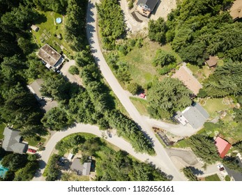 Aerial view of  residential homes in a small town, Blind Bay, during a vibrant sunny summer day. Taken in the Interior BC, Canada.