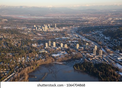 Aerial view of Residential Neighborhood during a vibrant sunset. Taken in Port Moody, Greater Vancouver, British Columbia, Canada.