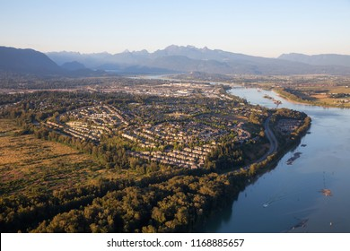Aerial view of residential neighborhood in Port Coquitlam during a sunny summer sunset. Taken in Vancouver, BC, Canada.