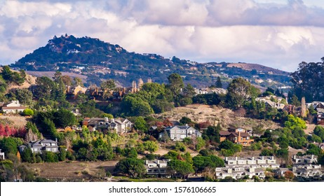 Aerial view of residential neighborhood with scattered houses build on hill slopes, Mill Valley, North San Francisco Bay Area, California