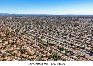 Aerial view of residential rooftops and the growth in east Mesa, Arizona