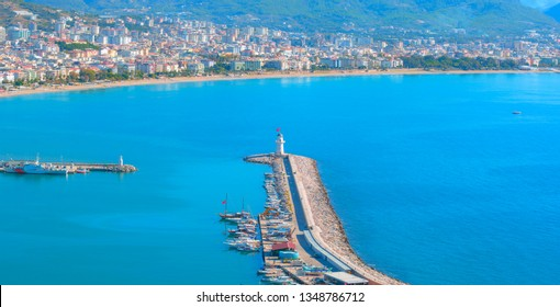 Aerial view of Resort town of Alanya City - Lighthouse in the port of Alanya, Turkey