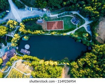 Aerial view of a restaurant by the lake / tennis court / villas park