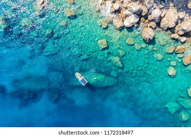 Aerial view of a rib boat with snorkelers and divers at the turquoise colored coast of the Aegean Sea in Greece