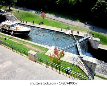 aerial view of the Rideau Canal and one of its water locks near the Ottawa River, along the Bytown museum and the Chateau Laurier hotel. travel and tourism Canada concept. Ontario waterways system.