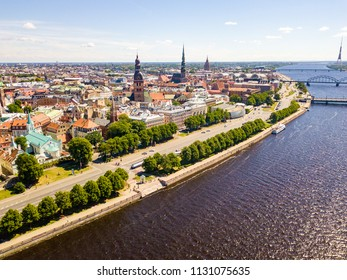 Aerial view of Riga city - capital of Latvia. Amazing view on the river Daugava, old town, national library, bridges over the river and the main TV tower.