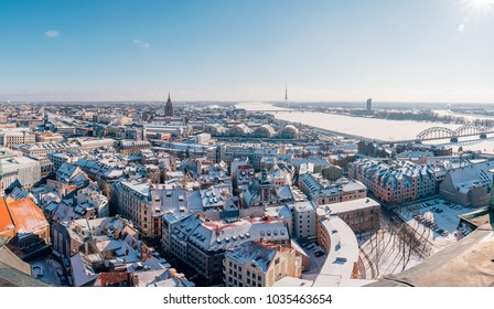 Aerial view of the Riga during winter time with Dome Cathedral, statue of liberty, Daugava river and national library.