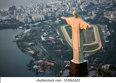 Aerial view of rio de janeiro with the christ redeemer with the city at background.