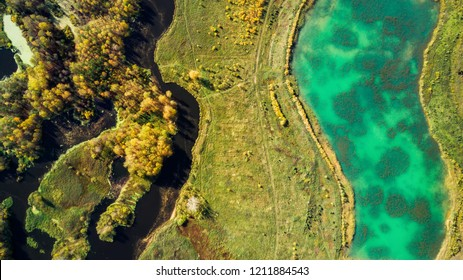 Aerial view of river after gold mining by dredge in Russia, Middle Urals, shot by drone