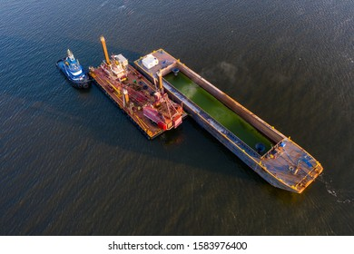 Aerial view of river dredging equipment in St. Johns River.