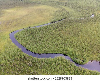Aerial view of river and forest in natural park northern Lapland, Finland