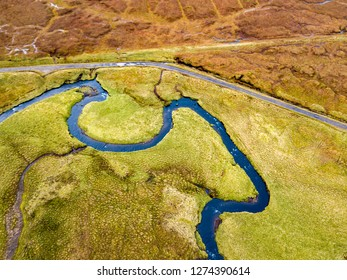 Aerial view of the River Lealt and Single track at Loch Cuithir and Sgurr a Mhadaidh Ruadh - Hill of the Red Fox, Isle of Skye, Scotland - UK