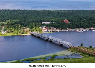 Aerial view of river Lielupe. Jurmala from above. Aerial view of river Lielupe railway bridge in Latvia.