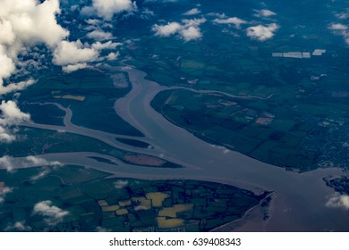 Aerial view  of a river mouth with clouds in foreground, south east England