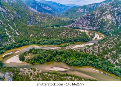 Aerial view of the river Nestos in Xanthi, Greece. The Nestos River forms on its long journey landscapes of unique beauty with rich forests, rare wetlands. favorite destination for canoe and kayak - Shutterstock ID 1451462777