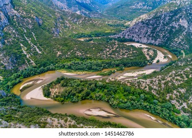 Aerial view of the river Nestos in Xanthi, Greece. The Nestos River forms on its long journey landscapes of unique beauty with rich forests, rare wetlands. favorite destination for canoe and kayak - Shutterstock ID 1451462786