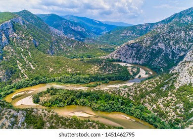 Aerial view of the river Nestos in Xanthi, Greece. The Nestos River forms on its long journey landscapes of unique beauty with rich forests, rare wetlands. favorite destination for canoe and kayak - Shutterstock ID 1451462795