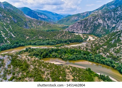 Aerial view of the river Nestos in Xanthi, Greece. The Nestos River forms on its long journey landscapes of unique beauty with rich forests, rare wetlands. favorite destination for canoe and kayak - Shutterstock ID 1451462804