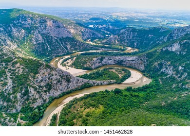 Aerial view of the river Nestos in Xanthi, Greece. The Nestos River forms on its long journey landscapes of unique beauty with rich forests, rare wetlands. favorite destination for canoe and kayak - Shutterstock ID 1451462828
