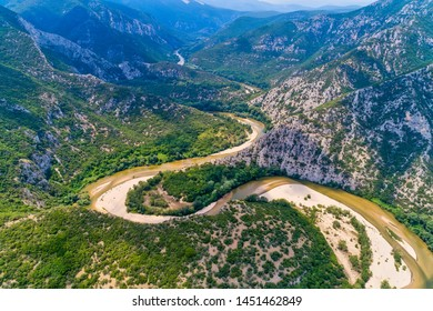 Aerial view of the river Nestos in Xanthi, Greece. The Nestos River forms on its long journey landscapes of unique beauty with rich forests, rare wetlands. favorite destination for canoe and kayak - Shutterstock ID 1451462849