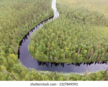 Aerial view of river and nordic forest in Lapland, Finland