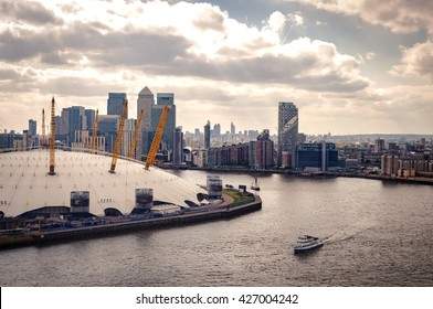 Aerial view of River Thames, North Greenwich and the Docklands on a cloudy day in London, England, UK