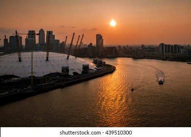 Aerial view of River Thames, North Greenwich and the Docklands on a cloudy day at sunset in London, England, UK