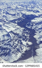 Aerial view of River valley in Snow clad mountains of Greater Himalaya in India