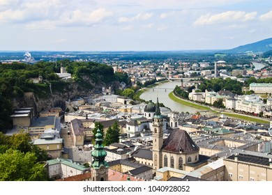 aerial view of river winding through the old town of salzburg austria