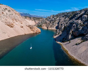 Aerial view of river Zrmanja in Zadar county, the river flows to Adriatic sea, Zrmanja canyon, boat sailing
