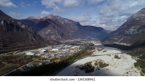 Aerial view of the riverbed of the Piave river with the industrial area of Villanova and the village of Longarone in the background. Belluno province/Italy