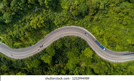 aerial view road curve construction up to mountain