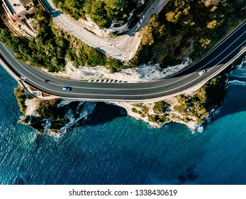 Aerial view of road going along the mountain and ocean or sea. Drone photography from above