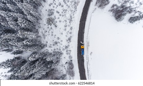 Aerial view of road maintenance in the winter.