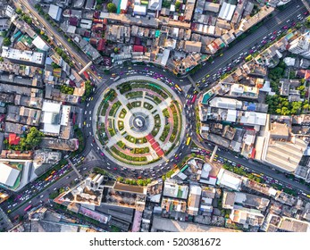 Aerial view Road roundabout with car lots Wongwian Yai in Bangkok,Thailand.street large beautiful downtown at night.cityscape.Top view.
