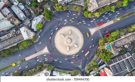 Aerial view, Road roundabout, Expressway with car lots in the city in Thailand.  beautiful Street , downtown, cityscape, Top view. Background road.