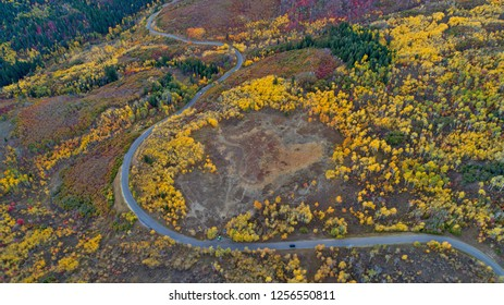 Aerial view of road winding through colorful Fall landscape