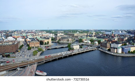 Aerial view of roads with car traffic and beautiful cityscape from the observation deck of Town Hall, way to Gamla Stan, Stockholm, Sweden