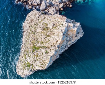 Aerial view of rock cliff Diva in Simeiz sea resort beach in Crimea, drone shot. Beautiful summer vacation nature landscape in mountain area, toned
