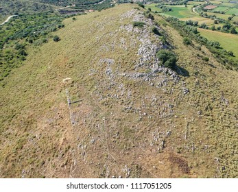 Aerial view of rock formation and ancient remains near the archaeological site of Necromanteion an ancient temple dedicated to the god of the Underworld, Hades, and his consort, the goddess Persephone