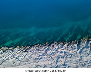 Aerial view of rocks on the sea. Overview of the seabed seen from above, transparent water. Croatia