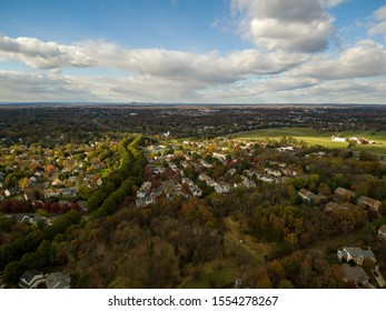 Aerial view of Rockville and Gaithersburg in Montgomery County, Maryland with Sugarloaf Mountain on the horizon.