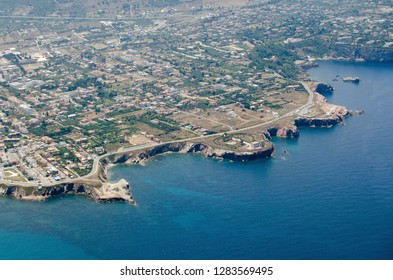 Aerial view of the rocky headland around Terrasini in the Palermo district of Sicily. In the middle is the historic Torre Alba, coastal defence tower which was built in the sixteenth century.
