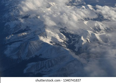 Aerial view of the rocky Mountains covered by snow