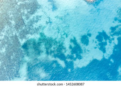 Aerial view of rocky seashore and the turquoise ocean shore
