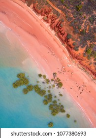 An aerial view of Roebuck Bay, Broome showing mangroves, red dirt and the outgoing tide.